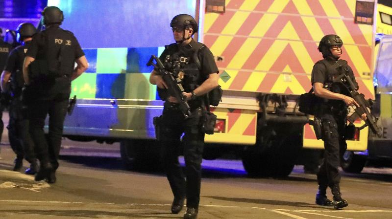 Armed police respond after reports of an explosion at Manchester Arena during an Ariana Grande concert in Manchester, England. (Photo:AP)