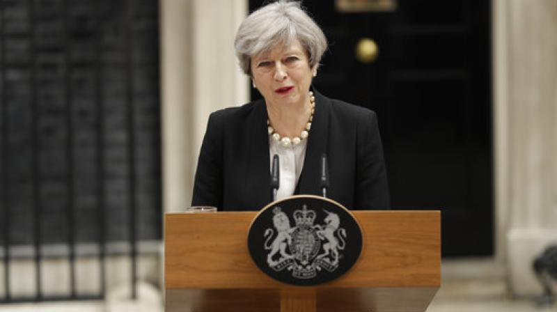 British Prime Minister Theresa May addresses the media outside 10 Downing Street, London. (Photo: AP)