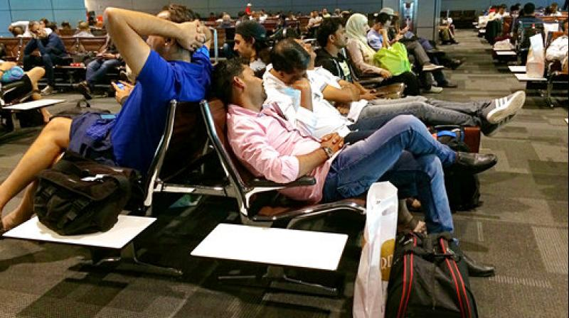 Passengers of cancelled flights wait in Hamad International Airport (HIA) in Doha, Qatar. (Photo: AP)