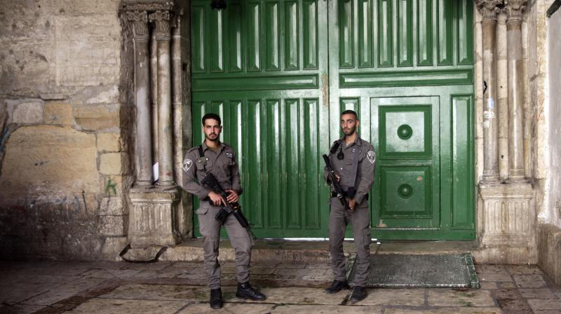 Border police officers stand guard at the entrance to the Al-Aqsa Mosque compound in Jerusalem's Old City. (Photo: AP)