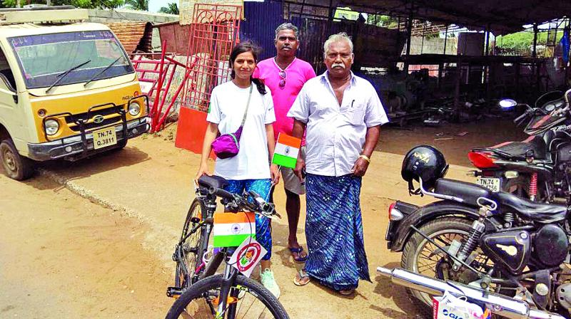 The monsoon hit her ride on the fourth day while travelling to Palakkad and accompanied her for more than 70 kilometres.