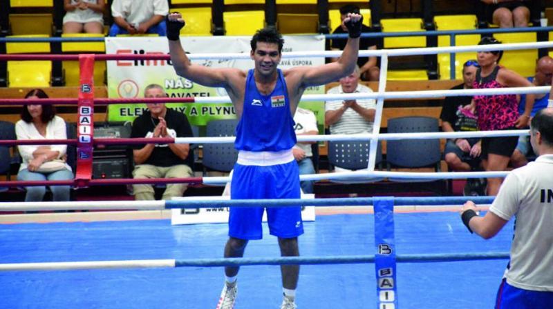 Manoj Kumar celebrates after winning the gold.