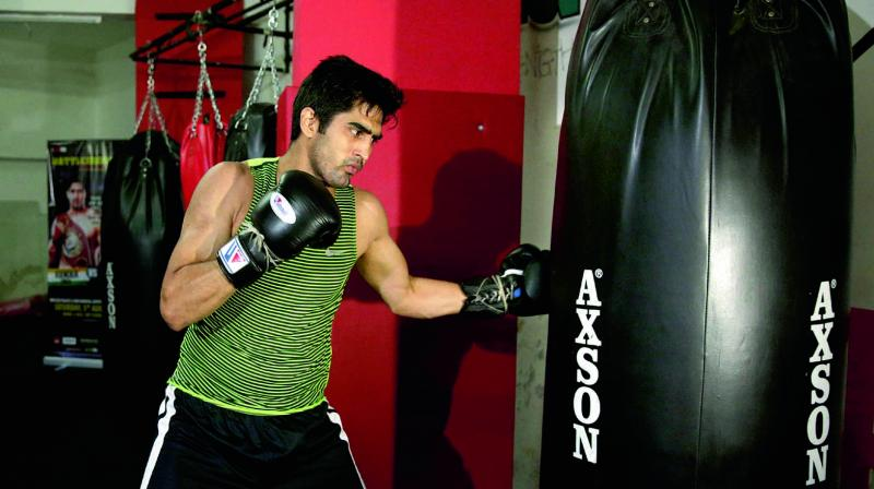 Vijender Singh's right hand was just too precise and powerful to handle for Adamu, who looked intimidated, kept a shell guard, and was thrown off-balance more than once. (Photo: AP)