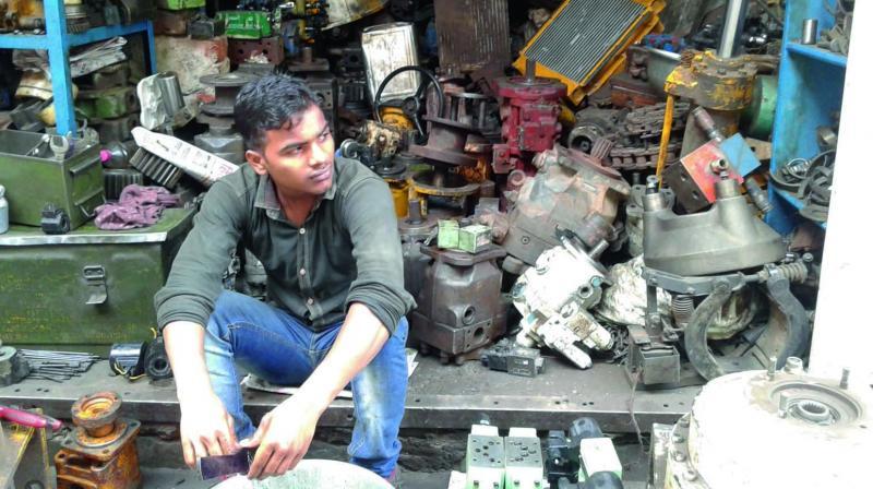 A scrap dealer outside his shop in Khazan Basti.