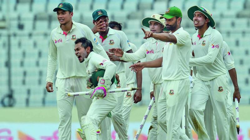 Bangladesh players celebrate their victory over Australia in the first Test at Dhaka on Wednesday. (Photo: AP)