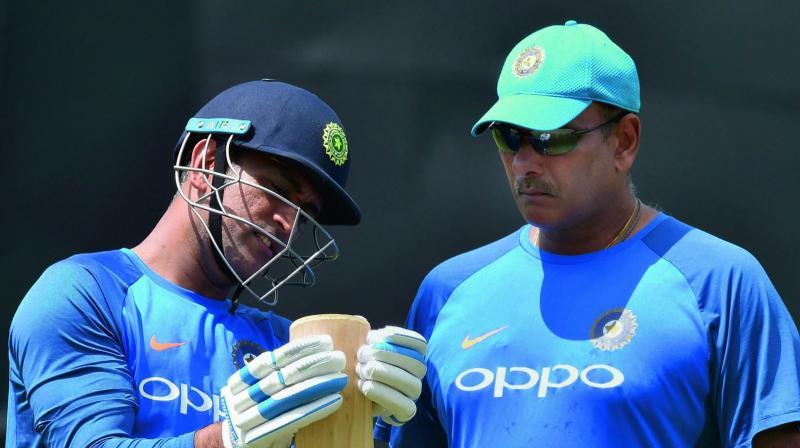 M.S. Dhoni and Ravi Shastri. (Photo: AP)