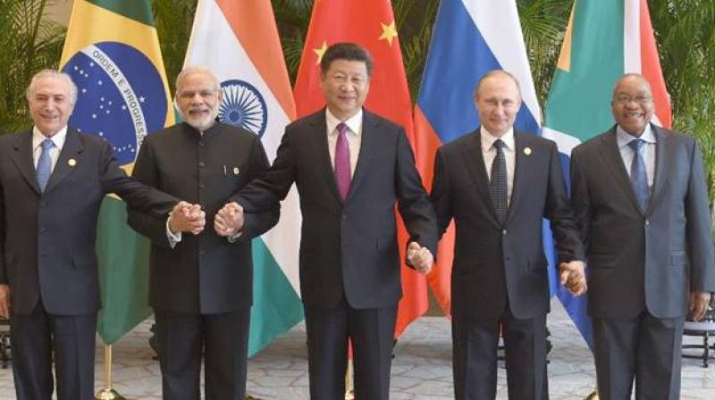 India, China and three other members of the BRICS group pledged to exchange tax information to address the problem of tax evasion. (Photo: AP)