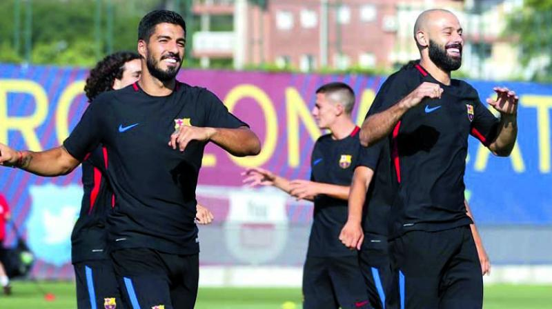 Barcelona's Luis Suarez (left) and Javier Mascherano at a training session.