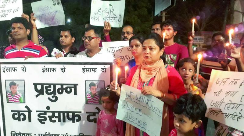 Residents of Delhi-NCR take part in a candlelight march on Sunday to seek justice for the boy who was killed in Ryan International School in Gurgaon. (Photo: G.N. Jha)