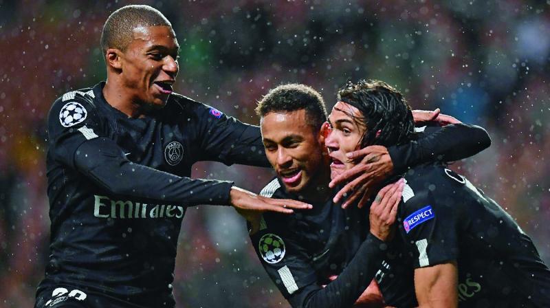 Paris Saint-Germain's Kylian Mbappe, Neymar and Edinson Cavani (R) celebrate during their 5-0 Pool B Champions League victory over Celtic at Celtic Park in Glasgow on Tuesday. (Photo: AFP)