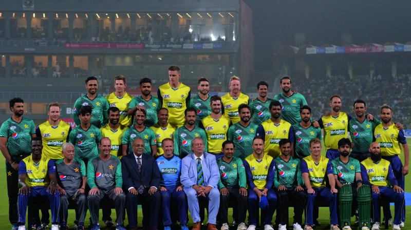 Members of the Pakistan and World XI teams pose at the Gaddafi Stadium in Lahore before the start of the second T20. (Photo: AFP)