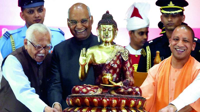 President Ram Nath Kovind being presented a statue of Lord Buddha by UP Governor Ram Naik and CM Yogi Adityanath during a civic reception in Lucknow on Thursday. (Photo: PTI)