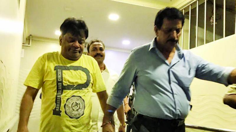 The Thane police on Monday evening arrested gangster Dawood Ibrahim's brother Iqbal Kaskar (yellow T-shirt) in connection with an extortion case.