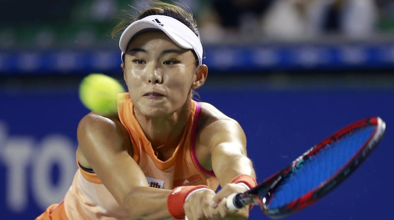 Wang Qiang of China returns a shot to Kristina Mladenovic of France during their first round match of the Pan Pacific Open tennis tournament in Tokyo, Monday. (Photo: AP)