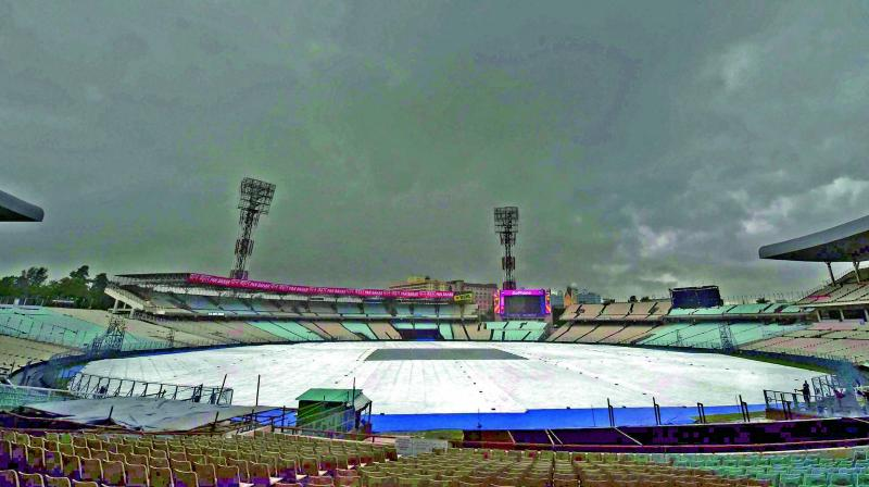 The Eden Gardens turf was covered on Tuesday. (Photo: PTI)