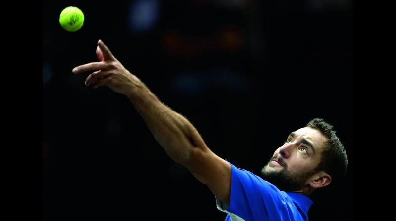 Team Europe's Marin Cilic serves to Frances Tiafoe of Team World during their Laver Cup tennis match in Prague on Friday. Cilic won 7-6 (3), 7-6 (0).	(Photo: AP)
