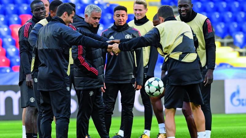 Manchester United coach Jose Mourinho and players at a training session in Moscow on Tuesday, the eve of their Champions League Group A match against CSKA Moskva. (Photo: AFP)