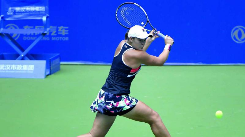 Barty began as well as possible, racing to a 5-0 lead within 12 minutes by winning 17 of the first 18 points. (Photo: AFP)