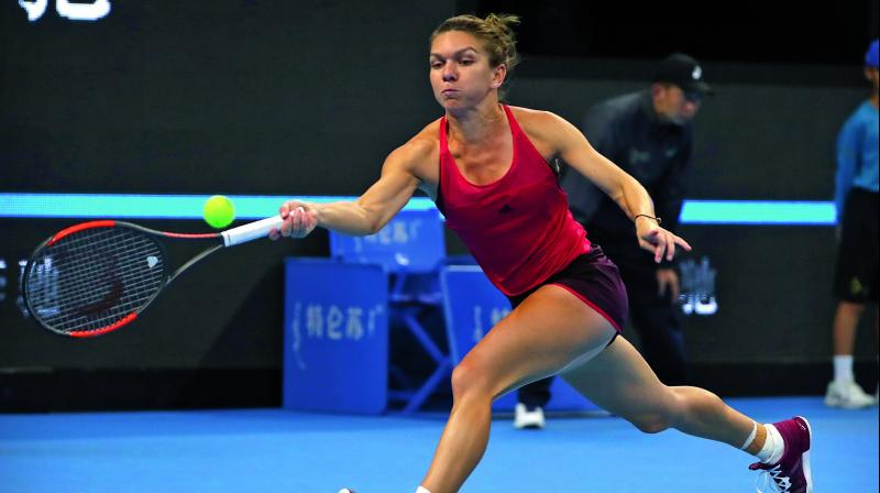 Romania's Simona Halep returns to Maria Sharapova of Russia in their China Open third round match at the Diamond Court in Beijing on Wednesday.	(Photo: AP)