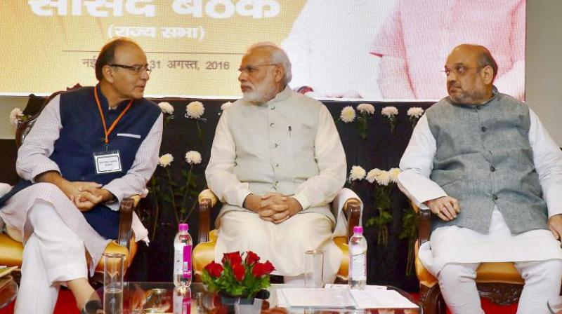Prime Minister Narendra Modi on Thursday held a meeting with BJP President Amit Shah and Finance Minister Arun Jaitley. Photo: PTI