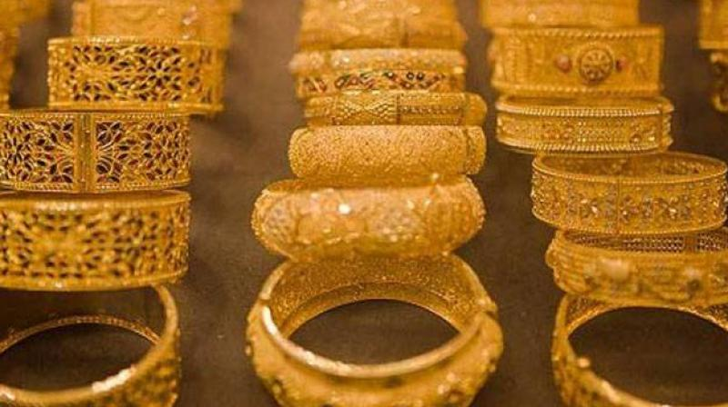 Demand for gold jewellery is likely to decline by 2-4 per cent this calender year due to high prices and subdued financing environment, said a report. (Photo: PTI)