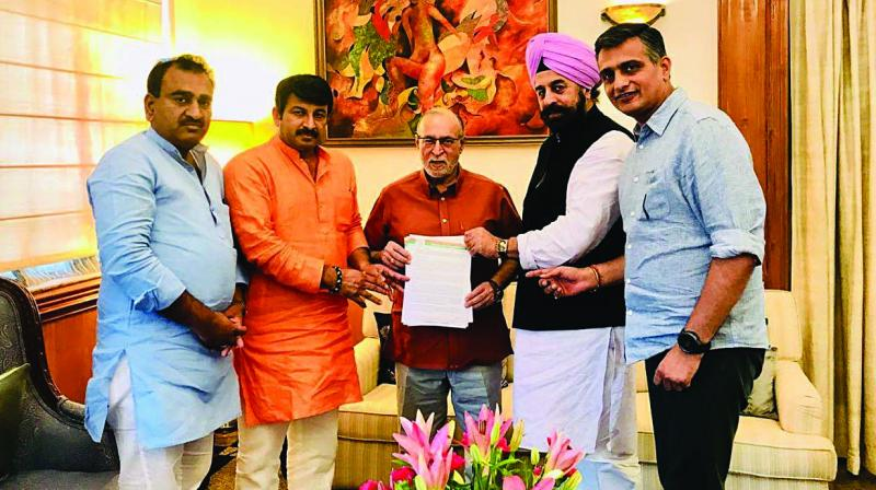 A BJP delegation submits a memorandum to L-G Anil Baijal on the irregularities in government hospitals, in New Delhi on Saturday.
