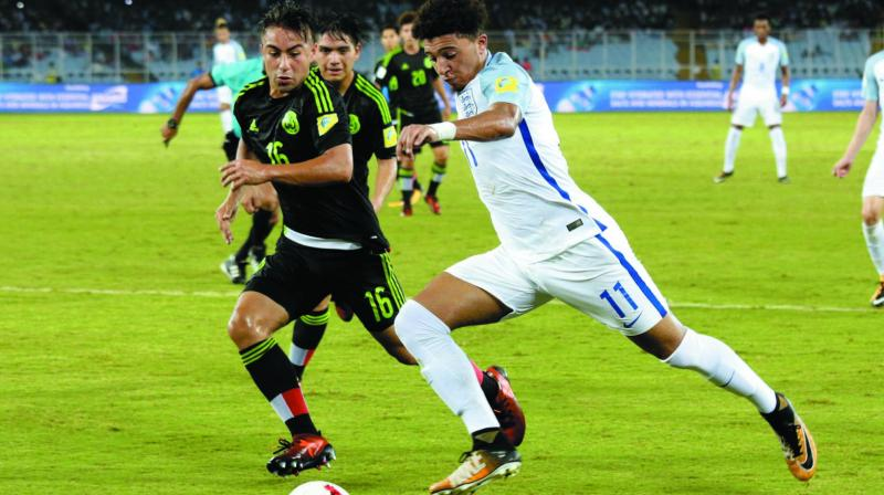 England's Jadon Sancho (right) in action against Mexico in their Group F match in Kolkata on Wednesday. England won 3-2. (Photo: AP)