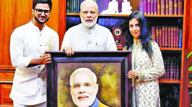 Artist Suvigya Sharma (L) and his wife Charu Suvigya Sharma (R) with Prime Minister Narendra Modi.