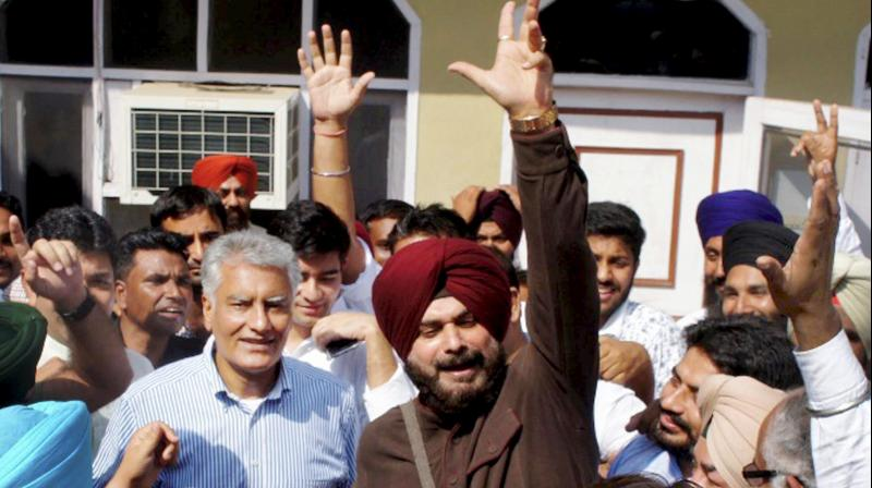 Navjot Singh Sidhu celebrates after winning the bypoll, in Gurdaspur on Sunday. (Photo: PTI)