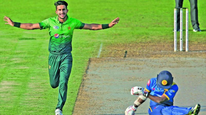 Pakistan's Hasan Ali celebrates the dismissal of Sri Lanka's Akila Dananjaya in their third ODI. (Photo: AP)