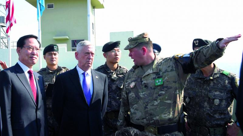 US defence secretary Jim Mattis and South Korean defence minister Song Young-moo visit Observation Post Ouellette in Paju near the truce village of Panmunjom in the demilitarised zone on the border between North and South Korea on Friday. (Photo: AP)