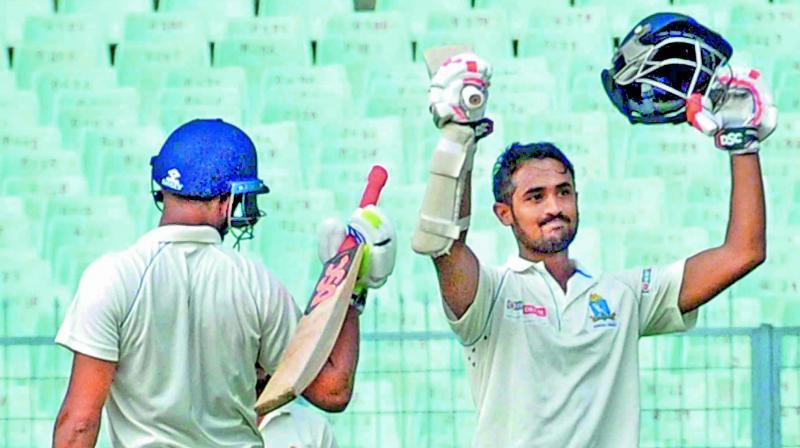 Bengal's Abhishek Raman celebrates his century against Himachal on Wednesday. (Photo: PTI)