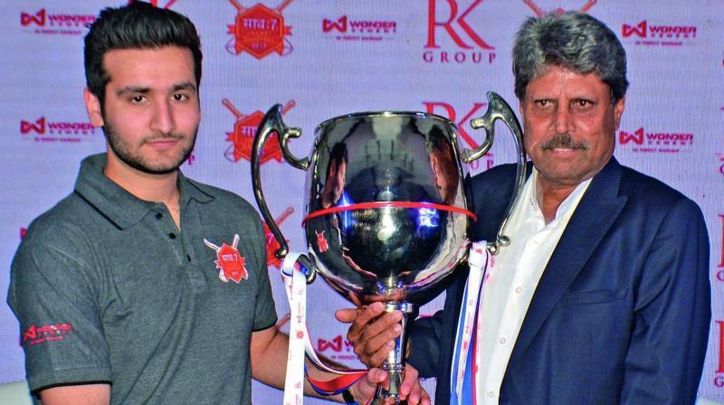 Kapil Dev unveils the 'Saath: 7 Cricket Mahotsav' trophy in New Delhi on Wednesday.