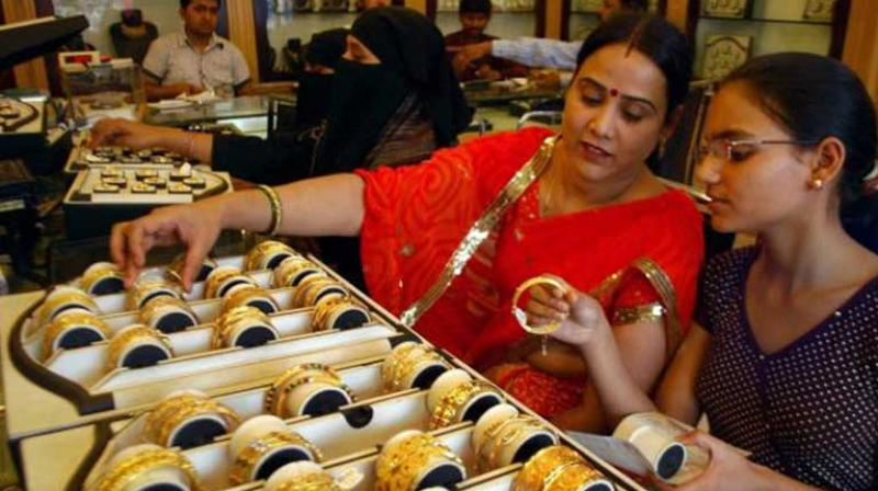 Gold is trading at Rs 30,931 per 10 grams in futures trade on Monday. (Photo: PTI)