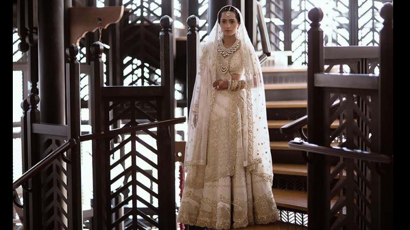 Kresha Bajaj in her own 'love' woven wedding lehenga