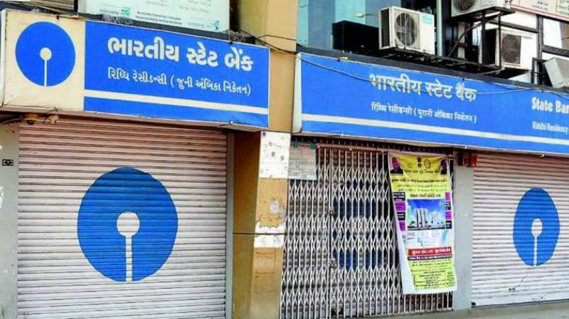 The nation-wide strike would impact banking services like deposits and withdrawal at branches, cheque clearances and issuance of demand drafts, among others. (Photo: PTI)