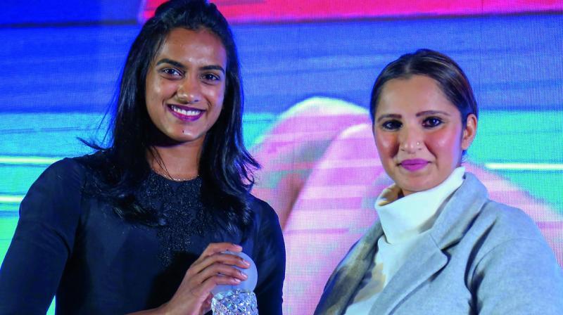 P.V. Sindhu and Sania Mirza at an awards function in Hyderabad. (Photo: PTI)