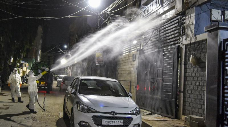 Disaster Response Force team spray disinfectant at Kaladera, Malakpet area to prevent the spread of coronavirus pandemic, during the nationwide lockdown, Hyderabad. PTI Photo
