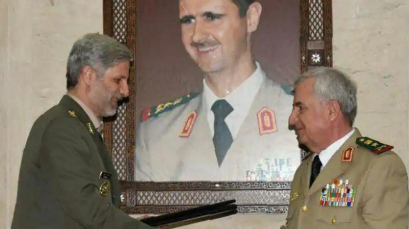 Iranian defence minister Amir Hatami (L) meeting with his Syrian counterpart Abdullah Ayoub (R) in the capital Damascus. Iran and Syria signed a deal for military cooperation in a meeting between the defence ministers of the two countries in Damascus, Iranian media reported on Monday. (Photo: AFP)
