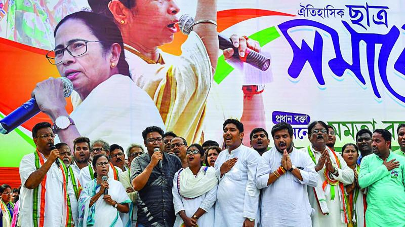 Chief minister Mamata Banerjee and others sing the National Anthem during Trinamul Chhatra Parishad Foundation Day rally in Kolkata on Wednesday. (Photo: PTI)