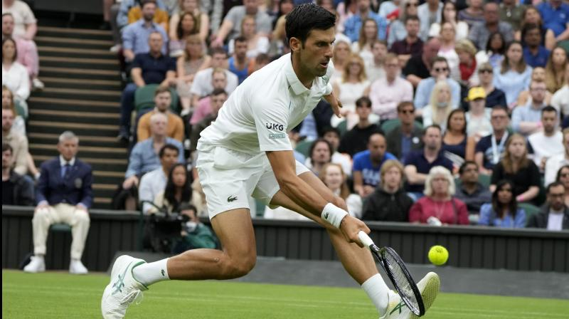 Serbia's Novak Djokovic reacts after losing a point to Britain's Jack Draper during the men's singles match of the Wimbledon in London on Monday. (Photo: AP)