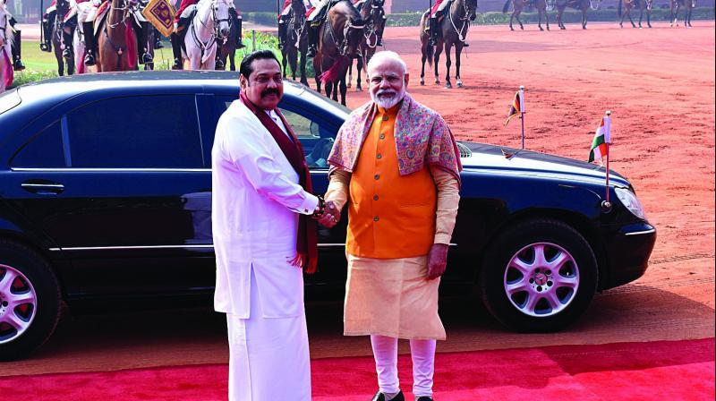 Prime Minister Narendra Modi with his Sri Lankan counterpart Mahinda Rajapaksa during a reception at Rashtrapati Bhawan in New Delhi on Saturday. (Photo: ASIAN AGE)