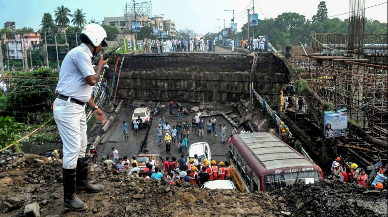 Labourers working on the metro project claimed two of their co-workers, who were probably inside a temporary shelter underneath the bridge, are still missing.(Photo: PTI)