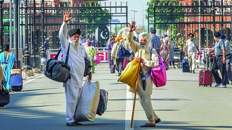 Devotees leave for Pakistan via the Attari-Wagah border on Tuesday. (Photo: PTI)