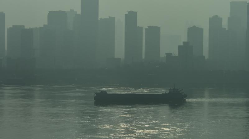 A ship sails along the Yangtze in Wuhan, China's central Hubei province on January 28, 2020, amid a deadly virus outbreak which began in the city. (AFP)