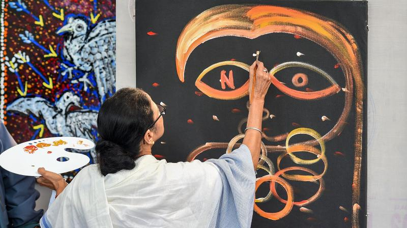 West Bengal chief minister Mamata Banerjee paints during a protest against the Citizenship Amendment Act (CAA) and the National Register of Citizens (NRC) at an art camp in Kolkata, Tuesday, Jan. 28, 2020. (PTI Photo)