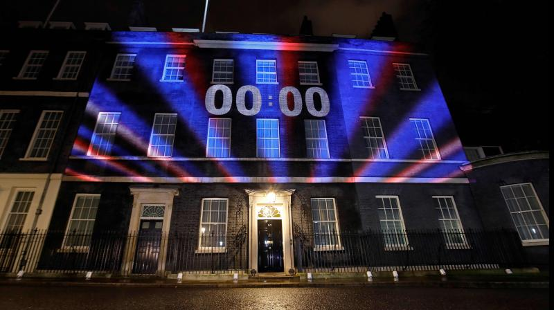 Red, white and blue lights illuminate 10 Downing Street, the official residence of Britain's prime minister, in central London on January 31, 2020, after Britain left the European Union at 2300GMT. Brexit supporters gathered outside parliament to cheer Britain's departure from the European Union following three years of epic political drama.(AFP)