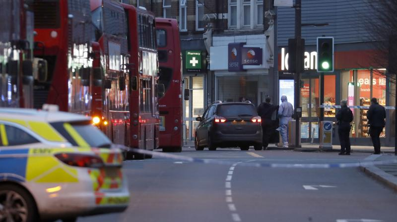A police forensic officer works near the scene after a stabbing incident in Streatham, London on Sunday, Feb. 2, 2020. London police officers shot and killed a suspect after three people were stabbed Sunday in what authorities are investigating as a terror attack. (AP)