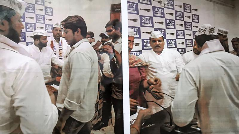 In this undated photo provided by the Delhi Police Crime Branch, Shaheen Bagh shooter Kapil Baisala is seen with Aam Aadmi Party (AAP) leaders. Police say Baisala is a member of the AAP.  (PTI Photo)