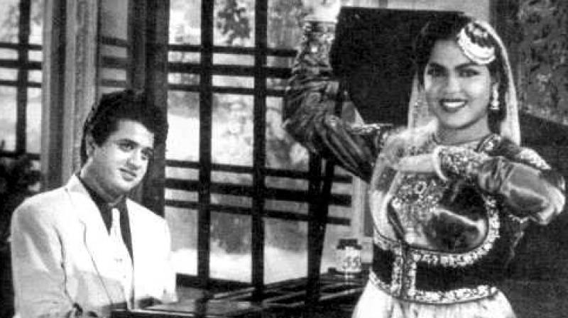 That's Jaikishen of Shankar-Jaikishen fame on the piano and Shakila doing a number in the film Begunah, which was banned for plagiarism.